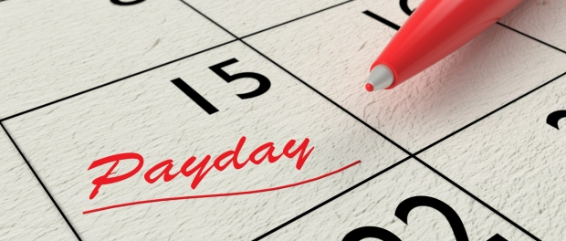 Red ballpen on a paper calendar closeup