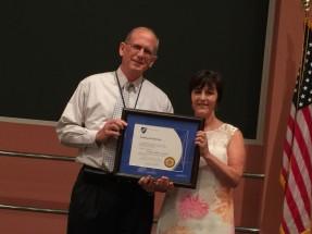 John McDonald recognizes the service of Diane Mancinelli.